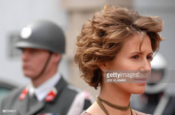 The wife of Syrian President Bashar alAssad Asma listens to national anthems during welcoming ceremonies on April 27 2009 for her husband at the...
