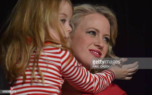 The wife of the Leader of the Australian Labor Party Bill Shorten Chloe holds their daughter Clementine as he speaks onstage about the success of the...