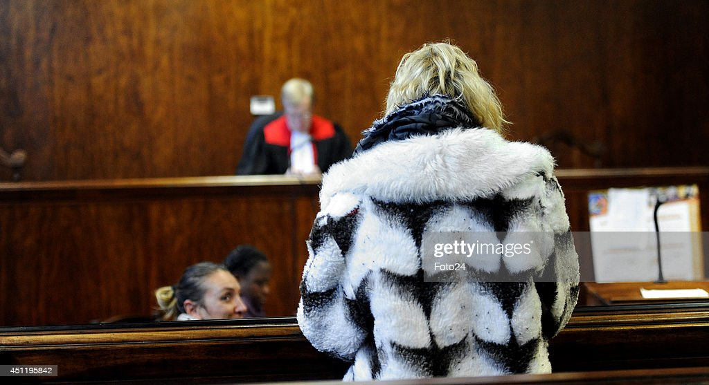 The wife of the Springs Monster appears at the Springs Magistrate's court on June 24, 2014 in Springs, South Africa. The mother of five was arrested on Monday in connection with the same charges laid against her husband. The husband is accused of holding his family captive and abusing them for years.