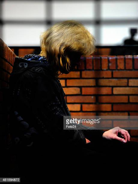 The wife of the Springs Monster appears at the Springs Magistrate's court on July 1 2014 in Springs South Africa The mother of five is facing similar...