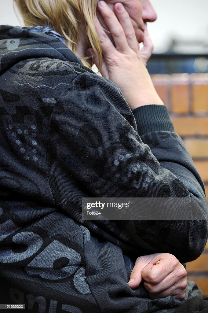 The wife of the Springs Monster appears at the Springs Magistrate's court on July 2, 2014 in Springs, South Africa. The mother of five is facing similar charges that were laid against her husband who is accused of holding his family captive and abusing them for years. She faces charges of child abuse, attempted murder, assault with intent to do grievous bodily harm, and defeating the ends of justice. Her bail application will continue on Friday.