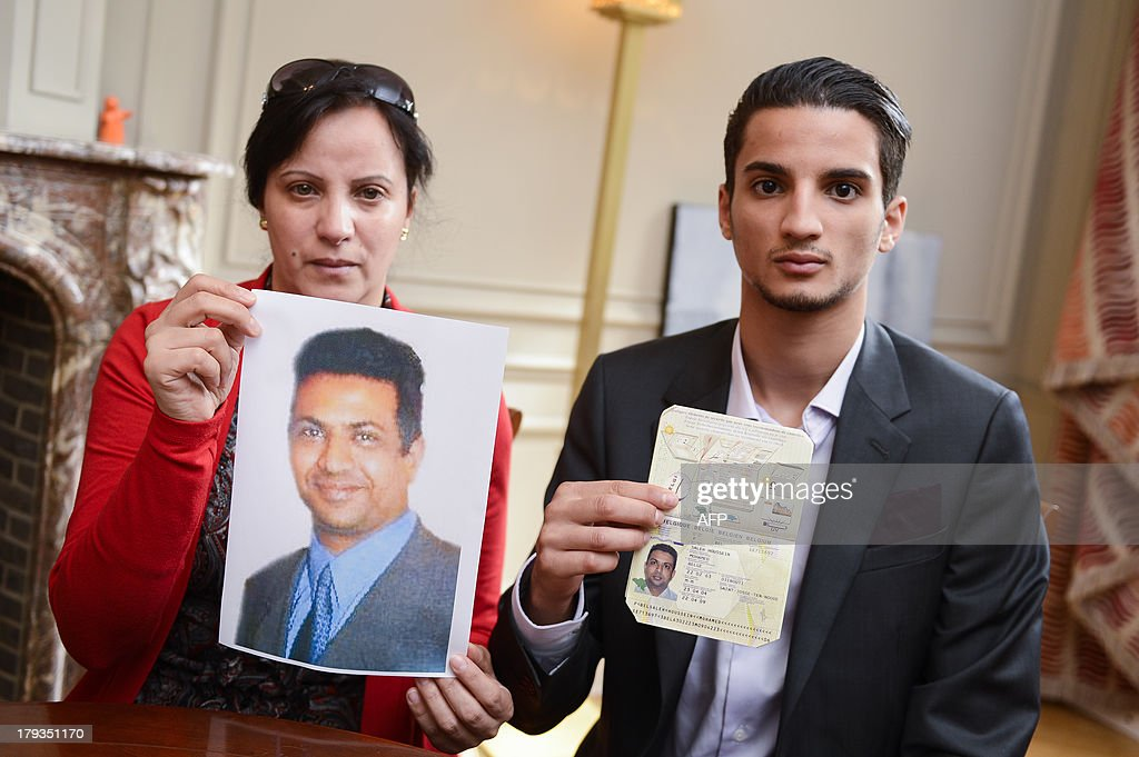 The wife of the witness in the case of the death of French judge Bernard Borrel, Asmae Abdelkadous (L), and the son of the witness, Moncef Mohamed Saleh, hold on September 2, 2013 in Brussels a picture and the Belgian passport of Mohamed Saleh Alhoumekani, who was arrested in Yemen last week. Yemeni-Belgian national Alhoumekani is the main witness in the case of Borrel, who was found murdered in Djibouti in 1995. His family and lawyer are calling upon the Belgian foreign minister to take diplomatic action and have Alhoumekani released.