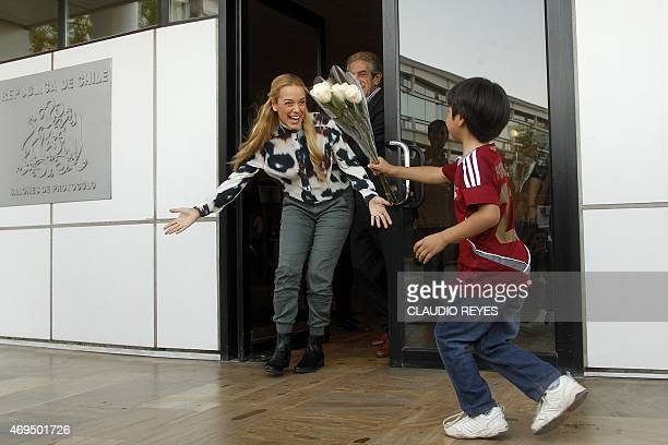 The wife of Venezuelan opponent Leopoldo Lopez Lilian Tintori arrives at the international airport in Santiago Chile on April 12 2015 as part of a...
