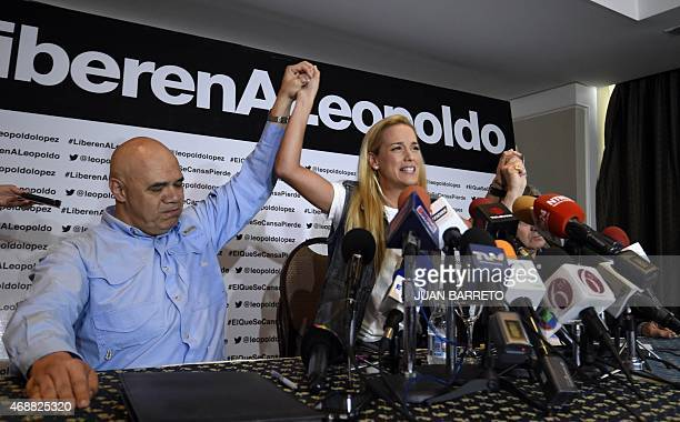The wife of Venezuelan opposition leader Leopoldo Lopez Lilian Tintori and the president of the Movement of Democratic Unity Jesus 'Chuo' Torrealba...