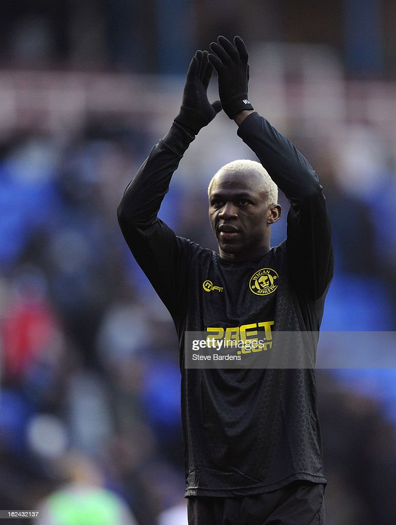 The Wigan Athletic goal scorer <a gi-track='captionPersonalityLinkClicked' href=/galleries/search?phrase=Arouna+Kone&family=editorial&specificpeople=550782 ng-click='$event.stopPropagation()'>Arouna Kone</a> applauds the Wigan fans after the Barclays Premier League match between Reading and Wigan Athletic at Madejski Stadium on February 23, 2013 in Reading, England.