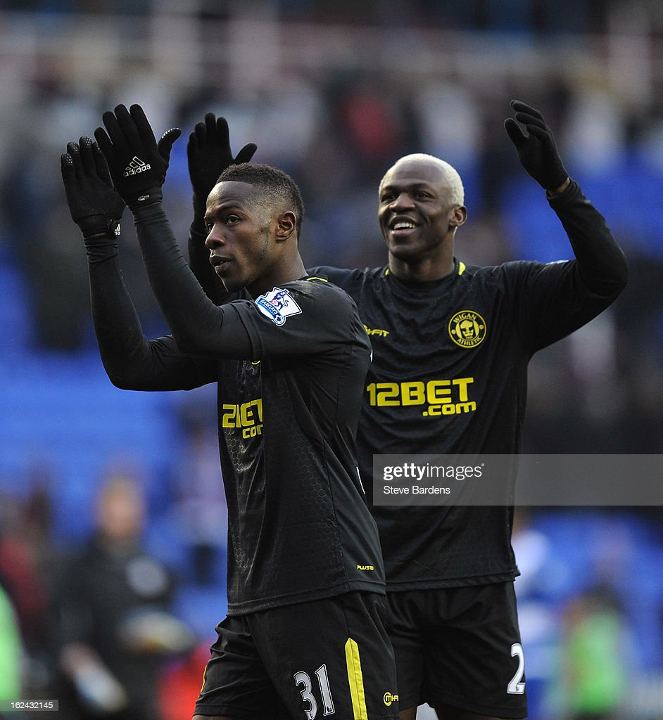 The Wigan Athletic goal scorers <a gi-track='captionPersonalityLinkClicked' href=/galleries/search?phrase=Maynor+Figueroa&family=editorial&specificpeople=882234 ng-click='$event.stopPropagation()'>Maynor Figueroa</a> (L) and <a gi-track='captionPersonalityLinkClicked' href=/galleries/search?phrase=Arouna+Kone&family=editorial&specificpeople=550782 ng-click='$event.stopPropagation()'>Arouna Kone</a> applaud their fans after the Barclays Premier League match between Reading and Wigan Athletic at Madejski Stadium on February 23, 2013 in Reading, England.