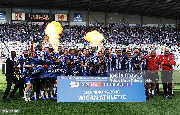 The Wigan Athletic players celebrate winning the 2015/16 Sky Bet League One Championship at the end of the Sky Bet League One match between Wigan...