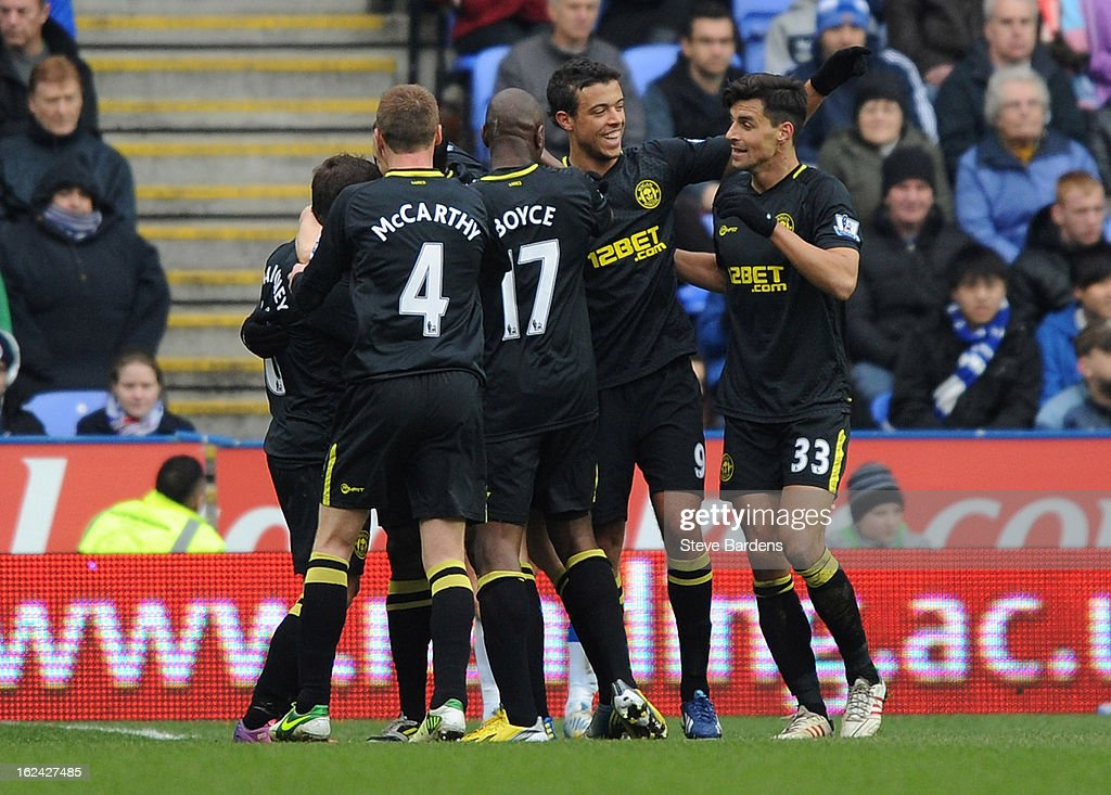 The Wigan Athletic players celebrate with <a gi-track='captionPersonalityLinkClicked' href=/galleries/search?phrase=Arouna+Kone&family=editorial&specificpeople=550782 ng-click='$event.stopPropagation()'>Arouna Kone</a> after he scored the opening goal during the Barclays Premier League match between Reading and Wigan Athletic at Madejski Stadium on February 23, 2013 in Reading, England.