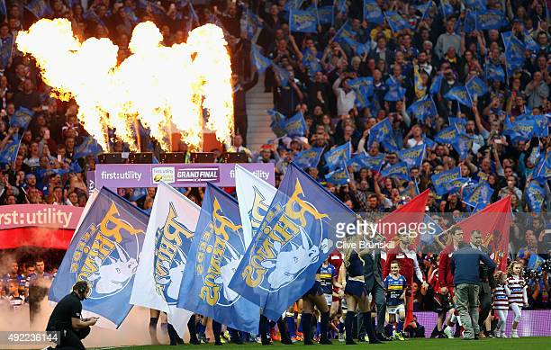 The Wigan Warriors and the Leeds Rhinos walk onto the field of play during the First Utility Super League Grand Final between Wigan Warriors and...