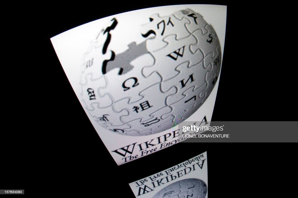 The 'Wikipedia' logo is seen on a tablet screen on December 4, 2012 in Paris. AFP PHOTO / LIONEL BONAVENTURE