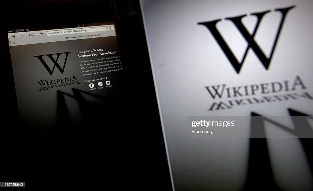 The Wikipedia website is arranged on a laptop and tablet computer in Beijing, China, on Wednesday, Jan. 18, 2012. Wikipedia, the online encyclopedia where users contribute entries, shut the English version of its website for 24 hours to protest Hollywood-backed anti-piracy measures in the U.S. Congress. Photographer: Nelson Ching/Bloomberg via Getty Images