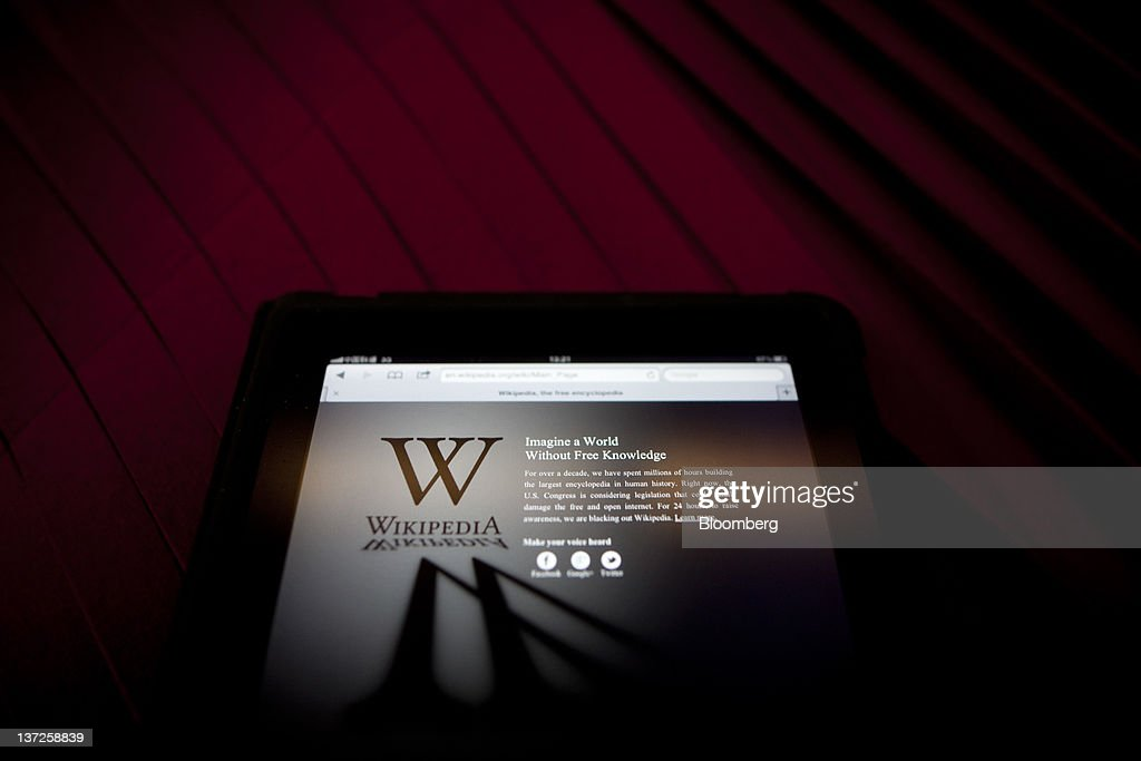 The Wikipedia website is arranged on a tablet computer in Beijing, China, on Wednesday, Jan. 18, 2012. Wikipedia, the online encyclopedia where users contribute entries, shut the English version of its website for 24 hours to protest Hollywood-backed anti-piracy measures in the U.S. Congress. Photographer: Nelson Ching/Bloomberg via Getty Images