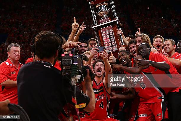 The Wildcats celebrate winning game three and the NBL Grand Final series between the Perth Wildcats and the Adelaide 36ers at Perth Arena on April 13...