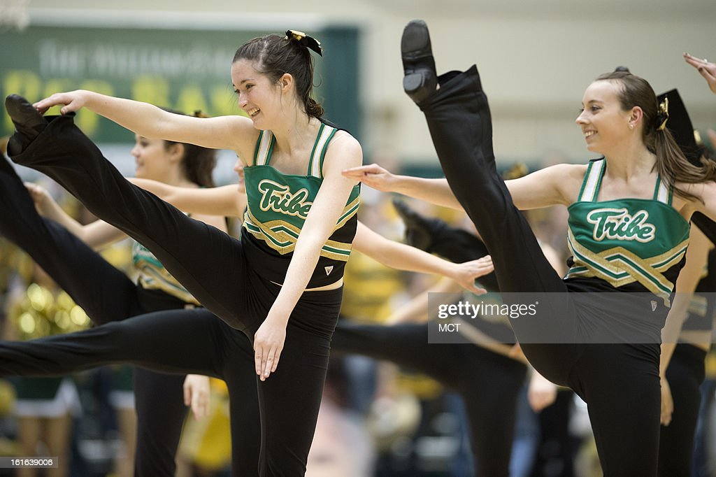 The William & Mary dance team performs during a timeout in the first half between William & Mary and North Carolina-Wilmington at Kaplan Arena in Williamsburg, Virginia, Wednesday, February 13, 2013. William & Mary defeated UNCW, 92-86.