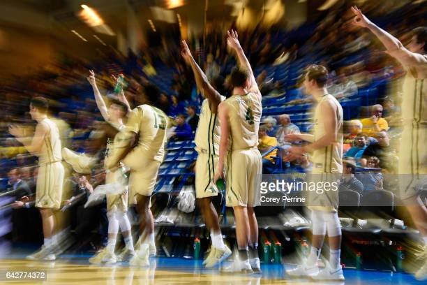 The William Mary Tribe bench signifies a three point basket against the Delaware Fightin Blue Hens during the second half at the Bob Carpenter Center...
