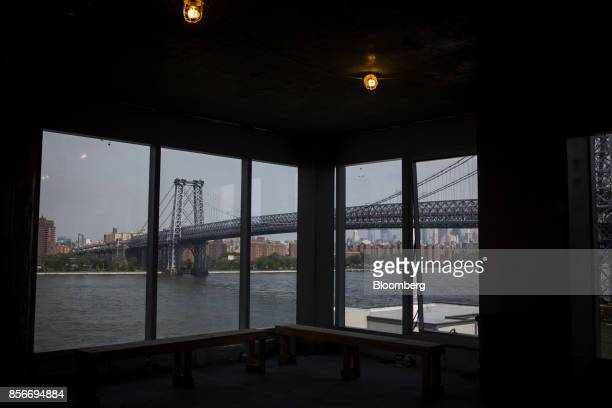 The Williamsburg bridge is seen in front of the Manhattan skyline from a unit in the 416 Kent Avenue apartment development under construction in the...