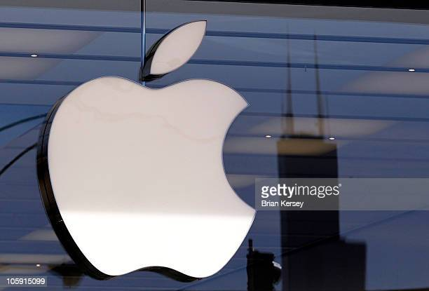 The Willis Tower is reflected in a window at the new Apple Store on October 21 2010 in Chicago Illinois The new store opens on October 23 in Lincoln...