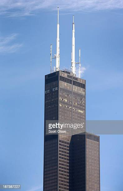 The Willis Tower rises above the city's skyline on November 8 2013 in Chicago Illinois The building which stands 1451 feet tall not including the...