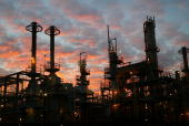 The Wilmington ARCO refinery is seen before dawn on December 19 2003 in Los Angeles California Crude oil prices have reached the highest level since...