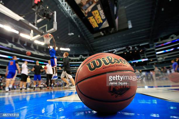 The Wilson basketball with the Final Four logo is seen as the Florida Gators practice ahead of the 2014 NCAA Men's Final Four at ATT Stadium on April...