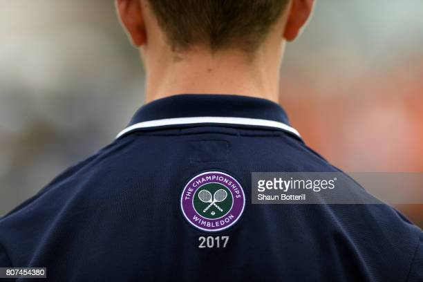 The Wimledon logo is seen on the back on a ball boy's tshirt on day two of the Wimbledon Lawn Tennis Championships at the All England Lawn Tennis and...