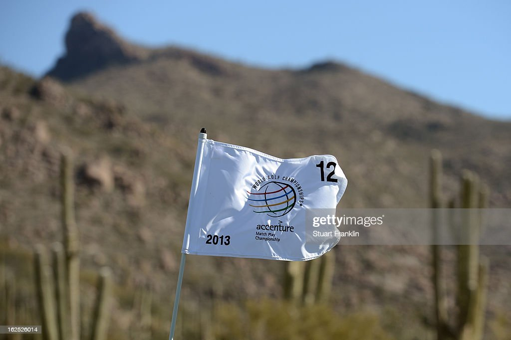 The wind blows the flag a top the pin on the 12th hole green during the semifinal round of the World Golf Championships - Accenture Match Play at the Golf Club at Dove Mountain on February 24, 2013 in Marana, Arizona.