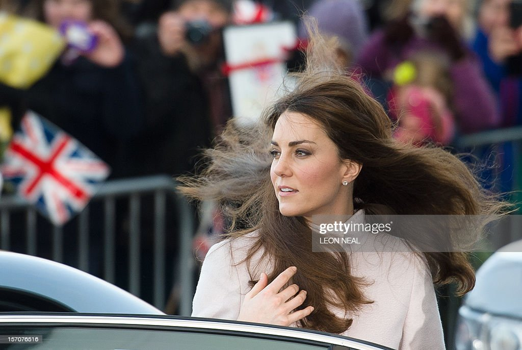 The wind blows the hair of Britain's Catherine, Duchess of Cambridge, as she arrives for a visit to Peterborough City Hospital in Peterborough, Cambridgeshire, north of London, on November 28, 2012. Britain's Prince William and his wife Catherine visited the university city that is home to their dukedom on November 28 for the first time since they were given their official titles.