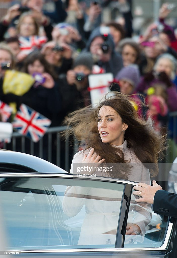 The wind blows the hair of Britain's Catherine, Duchess of Cambridge, as she arrives for a visit to Peterborough City Hospital in Peterborough, Cambridgeshire, north of London, on November 28, 2012. Britain's Prince William and his wife Catherine visited the university city that is home to their dukedom on November 28 for the first time since they were given their official titles. AFP PHOTO / LEON NEAL