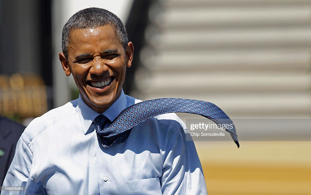 The wind picks up U.S. President <a gi-track='captionPersonalityLinkClicked' href=/galleries/search?phrase=Barack+Obama&family=editorial&specificpeople=203260 ng-click='$event.stopPropagation()'>Barack Obama</a>'s tie as he walks back to the Oval Office after welcoming the National Football League Super Bowl champions New York Giants to the White House June 8, 2012 in Washington, DC. The Giants defeated The New England Patriots 21-17 to win Super Bowl XXXXVI.