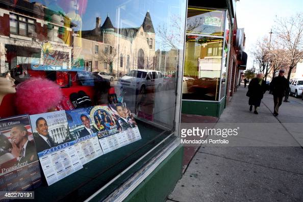 The window of a general store in a street in the Hyde Park Kenwood district displays a series of calendaries representing Barack Obama the former...