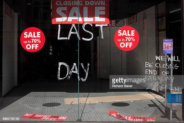 The window of a now vacant shop business window closed after its last day of trading in Oxford Street on 24th August 2016 London UK The words Last...