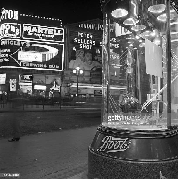 The window of Boots the Chemist in Piccadilly Circus London with the London Pavilion opposite 20th April 1965