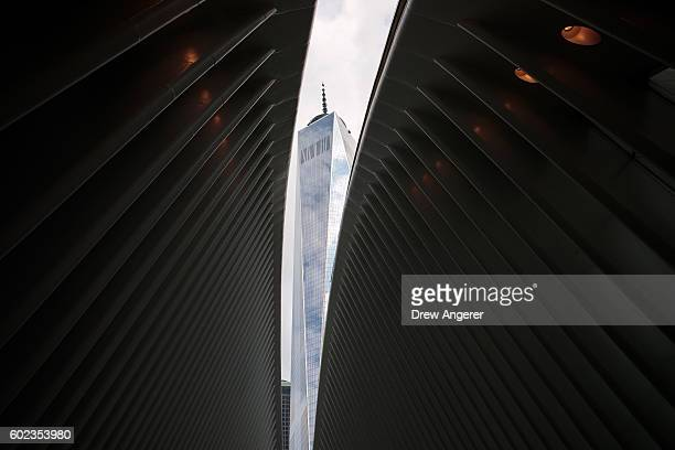 The windowed roof of the Oculus Transportation Hub is opened to reveal a view of One World Trade Center September 11 2016 in New York City Throughout...