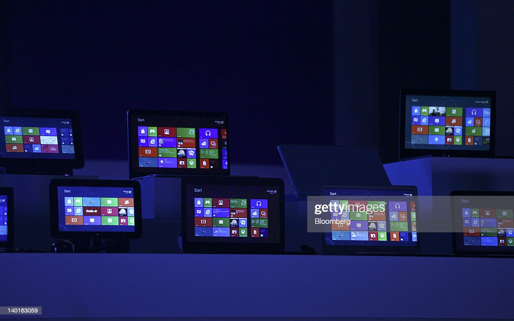 The Windows 8 software homepage is displayed on tablet devices at the Microsoft Corp. Windows 8 software consumer preview event at the Mobile World Congress in Barcelona, Spain, on Wednesday, Feb. 29, 2012. The Mobile World Congress, operated by the GSMA, expects 60,000 visitors and 1400 companies to attend the four-day technology industry event which runs Feb. 27 through March 1. Photographer: Chris Ratcliffe/Bloomberg via Getty Images