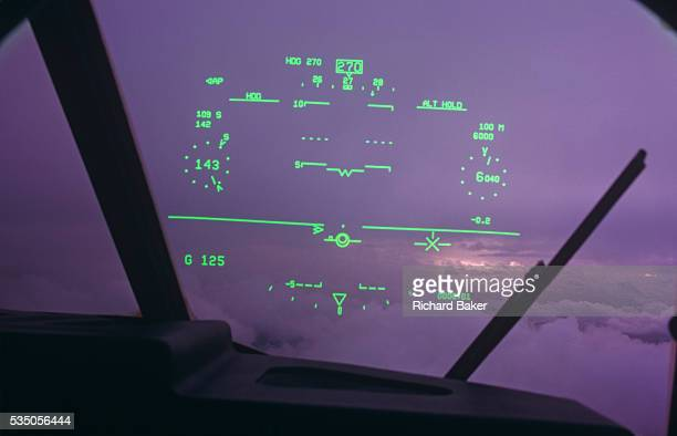 The windscreen of a Royal Air Force C130J Hercules to see a pilotseye view of his fixed headupdisplay while in flight over Hampshire during the...