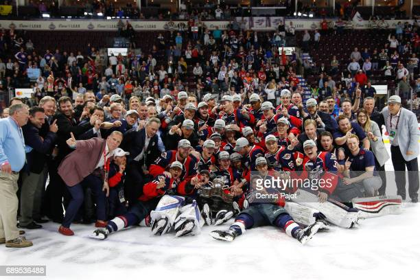 The Windsor Spitfires celebrate winning 43 against the Erie Otters on May 28 2017 during the championship game of the Mastercard Memorial Cup at the...