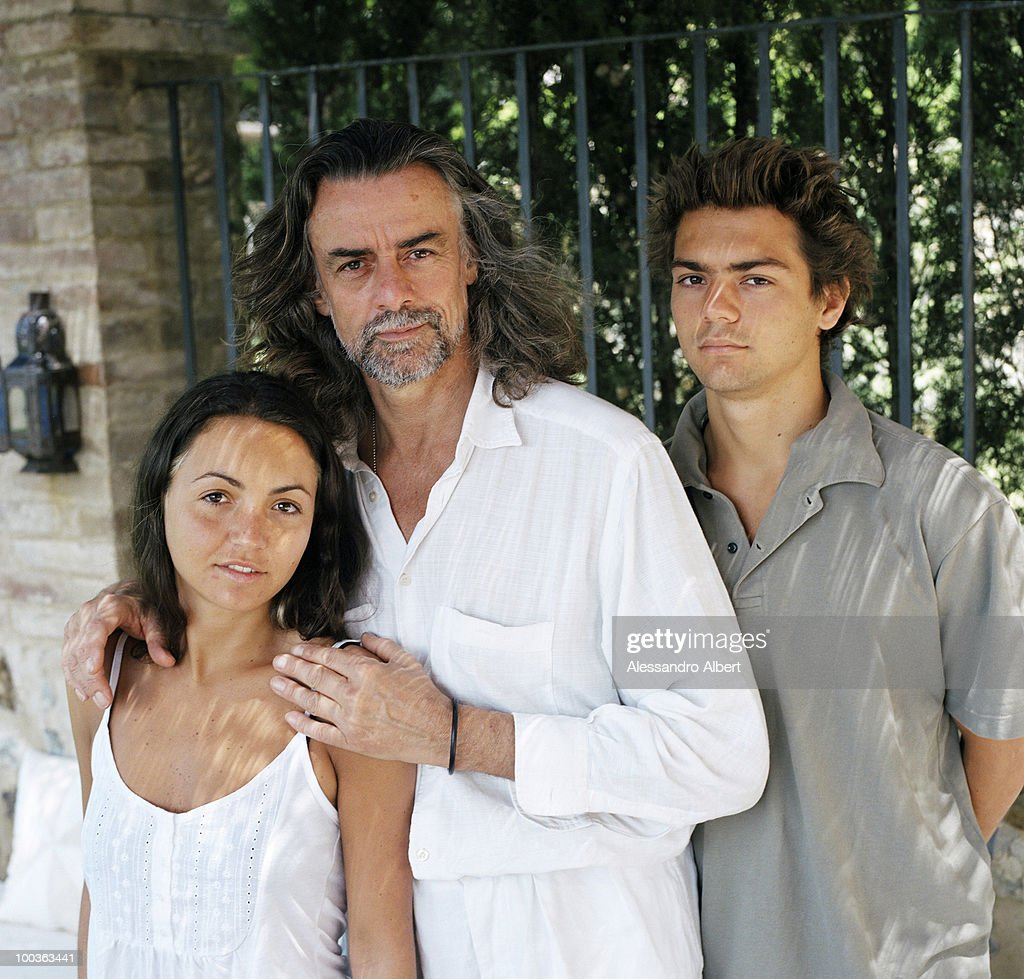 The wine consultant Gelasio Gaetani d'Aragona Lovatelli and his sons Cristoforo and Iacobella poses for a portraits session in the Villa Argiano on July 12, 2006 in Argiano, Italy