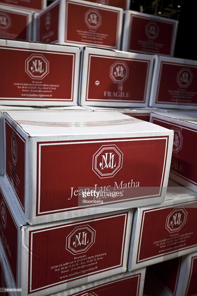 The wine maker's logo sits on boxes of wine, produced at Jean-Luc Matha's vineyard, before distribution in Clairvaux, France, on Thursday, Oct. 24, 2013. France's stocks of wine fell to the lowest in at least 12 years after the country's production plunged 19 percent last year, crop office FranceAgriMer said. Photographer: Balint Porneczi/Bloomberg via Getty Images