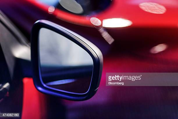 The wing mirror of the new Renault SA Kwid compact is displayed during a launch event in Chennai India on Wednesday May 20 2015 Renault is hoping to...