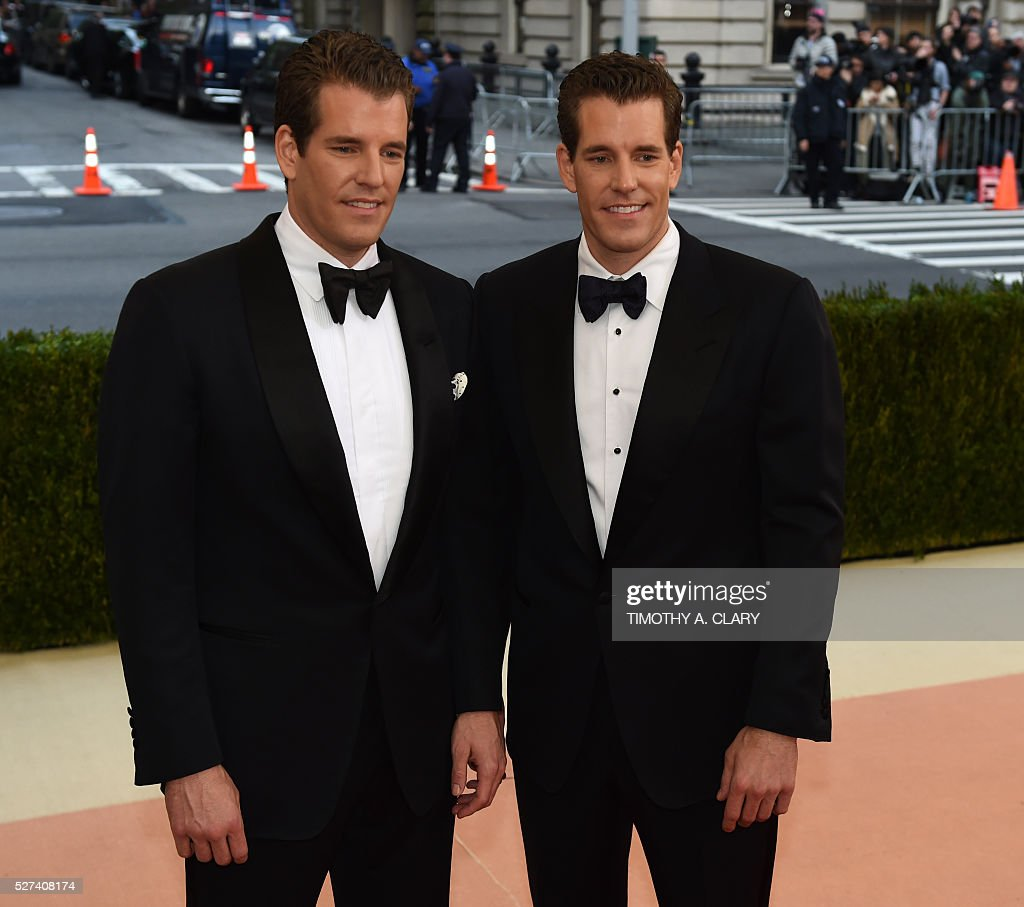 The Winklevoss twins arrive for the Costume Institute Benefit at The Metropolitan Museum of Art May 2, 2016 in New York. / AFP / TIMOTHY