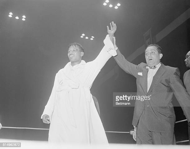 The Winnah San Francisco Sugar Ray Robinson has his hand raised in victory by IBC Rep Ben Bentley after he was awarded the decision against Rocky...