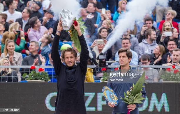 The winner Lucas Pouille of France and the runner up Aljaz Bedene of Great Britain pose with the trophy during the award ceremony at Gazprom...
