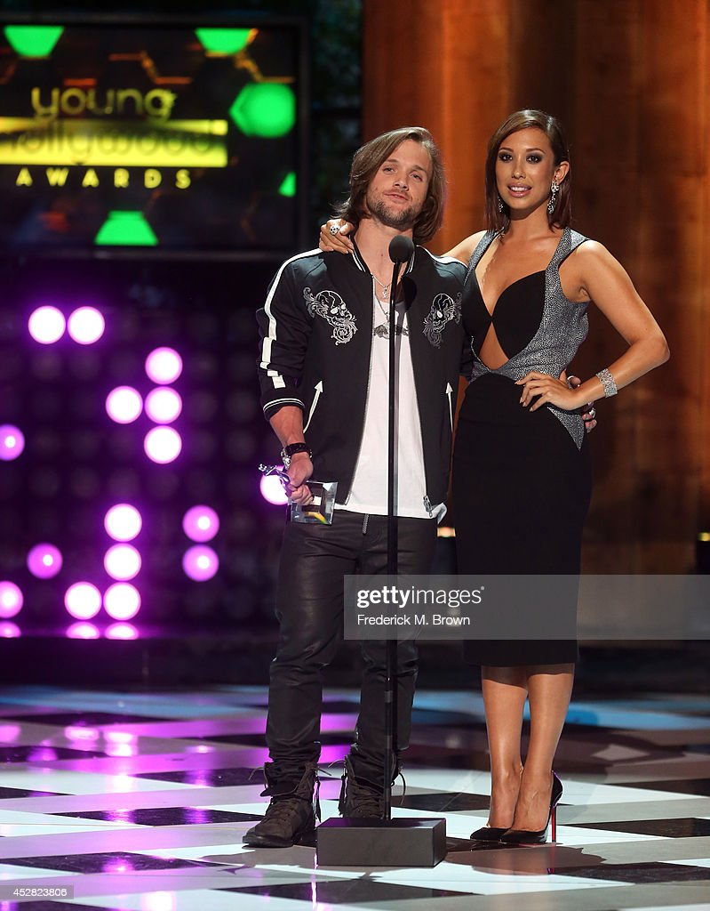 The winner of Most Awesome Athlete Award Professional Snowboarder Louie Vito and TV Personality Cheryl Burke onstage at the 2014 Young Hollywood...