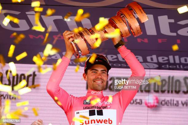 TOPSHOT The winner of the 100th Giro d'Italia Tour of Italy cycling race Netherlands' Tom Dumoulin of team Sunweb holds the trophy on the podium...
