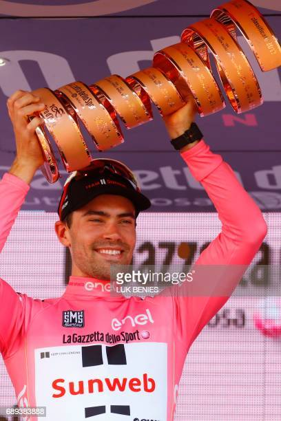 The winner of the 100th Giro d'Italia Tour of Italy cycling race Netherlands' Tom Dumoulin of team Sunweb holds the trophy on the podium after the...