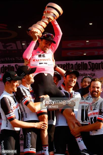 The winner of the 100th Giro d'Italia Tour of Italy cycling race Netherlands' Tom Dumoulin of team Sunweb celebrates with teammates on the podium...