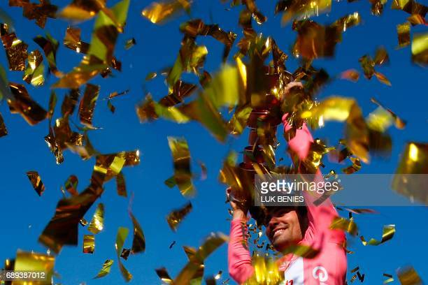 The winner of the 100th Giro d'Italia Tour of Italy cycling race Netherlands' Tom Dumoulin of team Sunweb holds the trophy on the podium near Milan's...