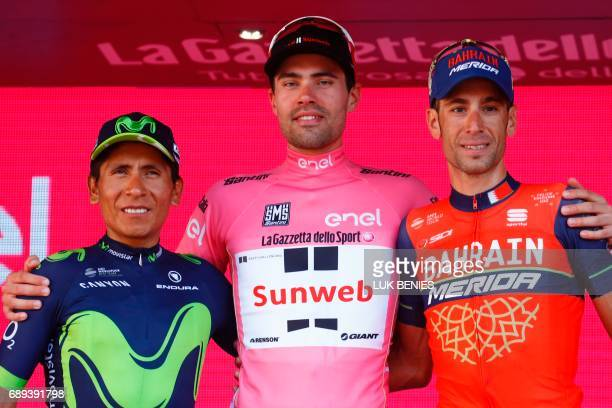 The winner of the 100th Giro d'Italia Tour of Italy cycling race Netherlands' Tom Dumoulin of team Sunweb celebrates on the podium with Italy's rider...