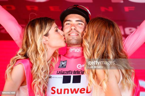 The winner of the 100th Giro d'Italia Tour of Italy cycling race Netherlands' Tom Dumoulin of team Sunweb celebrates on the podium after the last...
