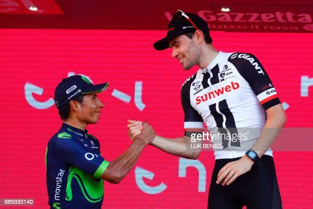 The winner of the 100th Giro d'Italia Tour of Italy cycling race Netherlands' Tom Dumoulin of team Sunweb is congratulated on the podium by...